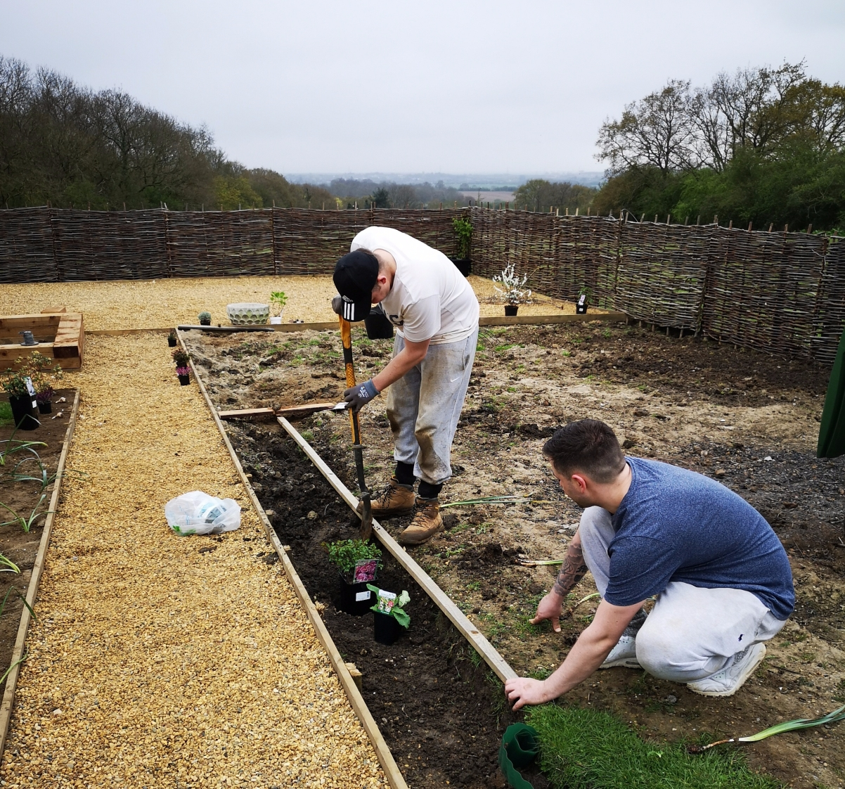Jamie and Billy levelling soil